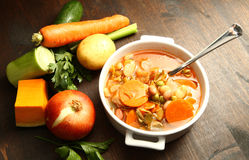 Minestrone. With fresh vgetables on wooden table Stock Photo