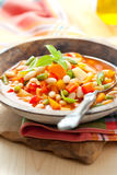 Minestrone. Bowl of minestrone soup with bread Royalty Free Stock Image