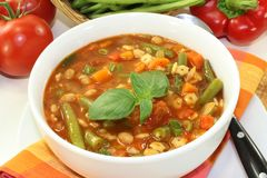 Minestrone. A bowl of minestrone soup and basil Stock Photography