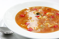 Minestrone. A bowl of minestrone soup ~ shell pasta with beans and vegetables.  Traditional Italian hearty meal Royalty Free Stock Photos