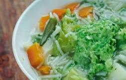 Minestrone alla genovese. Italian soup with pasta and pesto Stock Photo