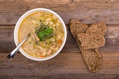 Minestrone with fresh pesto and brown seeded bread. Stock Photo