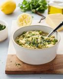 Minestrone, Italian vegetable soup with pasta and savoy cabbage stock photography