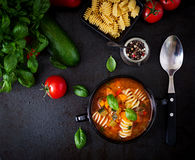Minestrone, italian vegetable soup with pasta. Top view. Stock Photos