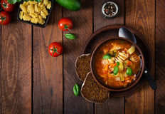 Minestrone, italian vegetable soup with pasta. On wooden table. Top view Royalty Free Stock Image