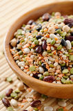 Minestrone mix. Wooden bowl full of dried legumes and cereals (minestrone mix Royalty Free Stock Photography