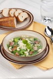 Minestrone soup. Closeup of bowl of hot fresh Minestrone soup and cheese garlic breadsticks Royalty Free Stock Photos