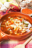 Minestrone soup. Thick vegetable minestrone soup with noodle and vegetables Stock Photography