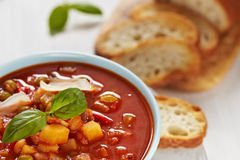 Minestrone soup. Bowl of minestrone soup with bread Royalty Free Stock Image