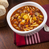 Minestrone Soup. A bowl of minestrone soup with bread Royalty Free Stock Photos