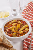 Minestrone Soup. A bowl of minestrone soup with bread and parmesan cheese Stock Images