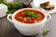 Minestrone soup. Bowl of minestrone soup with bread Stock Photography