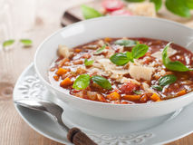 Minestrone. Soup with cheese and basil, selective focus Stock Images