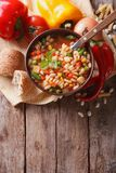 Minestrone soup closeup and ingredients. vertical top view Royalty Free Stock Photos