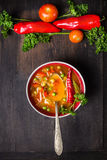 Minestrone soup on dark table with vegetables. Top view Stock Image