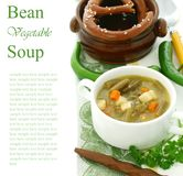 Minestrone soup with green beans, carrots and pota Stock Photos