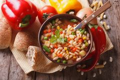 Minestrone soup and ingredients. horizontal top view closeup Stock Photo