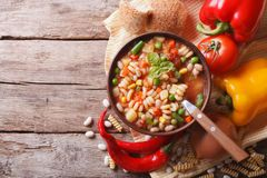 Minestrone soup and ingredients. horizontal top view Stock Images