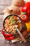 Minestrone soup and ingredients. vertical top view Royalty Free Stock Image