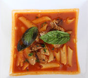 Minestrone soup with meat, pasta and basil. Minestrone - a thick italian soup Royalty Free Stock Photography