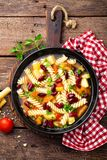 Minestrone soup. Vegetable soup with fresh tomato, celery, carrot, zucchini, onion, pepper, beans and pasta. Dish of italian cuisi Royalty Free Stock Photos