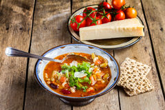 Minestrone vegetable soup with parmesan cheese . Close-up of minestrone soup  with bread and parmesan Royalty Free Stock Photos