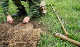 Minesweeper with a mine detector mine neutralizes Stock Photo