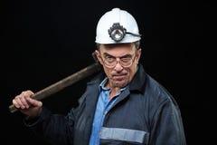 Mineur avec un marteau de forgeron Image stock
