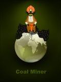 Mineur, sur le globe vert Images stock