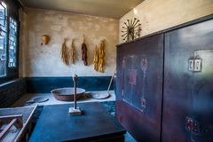 Ming Dynasty kitchen. An old kitchen with just a trough, table, cupboards and brick stove Royalty Free Stock Photos