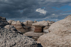 Mingan Monoliths and cloudscape. Monoliths on a cloudy sky in Mingan Archipelago National Park Reserve of Canada,Quebec, Canada royalty free stock photo