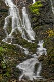 Mingo Falls Waterfall. Mingo Falls. It`s a scenic 150 foot waterfall not far from the Blue Ridge Parkway in Cherokee North Carolina. This is just a small portion stock images