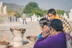 MINGUN-Myanmar, January 20, 2019 : Unidentified tourists make merit, pay homage to blessings at Mya Thein Tan Pagoda on january 20. 2019 in Mingun, Myanmar royalty free stock images