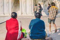 MINGUN-Myanmar, January 20, 2019 : Unidentified tourists make merit, pay homage to blessings at Mya Thein Tan Pagoda on january 20. 2019 in Mingun, Myanmar stock photography