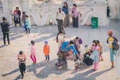 MINGUN-Myanmar, January 20, 2019 : Unidentified tourists make merit, pay homage to blessings at Mya Thein Tan Pagoda on january 20. 2019 in Mingun, Myanmar royalty free stock image
