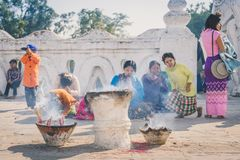 MINGUN-Myanmar, January 20, 2019 : Unidentified tourists make merit, pay homage to blessings at Mya Thein Tan Pagoda on january 20. 2019 in Mingun, Myanmar royalty free stock photo