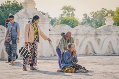MINGUN-Myanmar, January 20, 2019 : Unidentified tourists make merit, pay homage to blessings at Mya Thein Tan Pagoda on january 20. 2019 in Mingun, Myanmar stock photo
