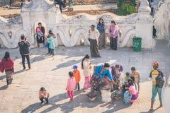 MINGUN-Myanmar, January 20, 2019 : Unidentified tourists make merit, pay homage to blessings at Mya Thein Tan Pagoda on january 20. 2019 in Mingun, Myanmar stock image