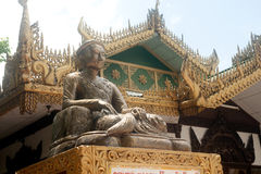 Mingun statue art with entrance gate in Kuthodaw temple. Royalty Free Stock Image