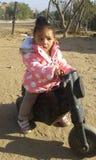 Minha filha em seu schooter Fotografia de Stock Royalty Free