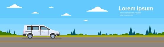Mini范Car On平路的横幅 免版税库存照片