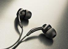 Mini écouteurs Photos stock