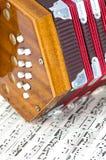 Mini Accordian na música de folha Foto de Stock Royalty Free