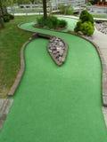 Mini agujero del golf foto de archivo
