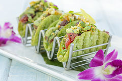 Mini Ahi Poke Tacos. Ahi poke tacos with avocado mousse, island salsa, bubu arare in a mini shell Stock Photography
