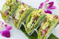Mini Ahi Poke Tacos. Ahi poke tacos with avocado mousse, island salsa, bubu arare in a mini shell Royalty Free Stock Photos