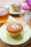 Mini Almond cake and tea on wooden table. selective focus Royalty Free Stock Photo