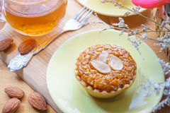 Mini Almond cake and tea on wooden table. selective focus Stock Photography