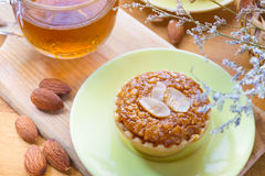 Mini Almond cake and tea on wooden table. selective focus Royalty Free Stock Image