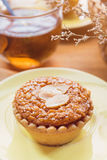 Mini Almond cake and tea on wooden table. selective focus Stock Images